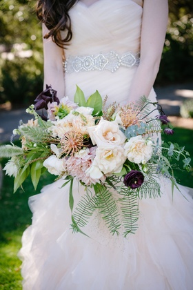 loosely-structured bridal bouquet with fern, eucalyptus, dark plum, blush, ivory blossoms