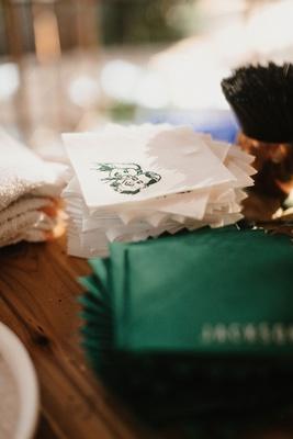 wedding reception bar wood with white napkin green drawing illustration portrait green napkin names