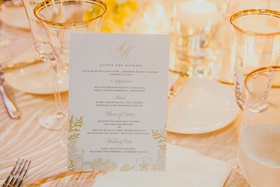 wedding menu card with gold coral details and monogram for destination wedding