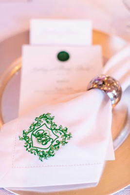 Wedding monogram embroidered on napkin ring at dinner table silver napkin ring