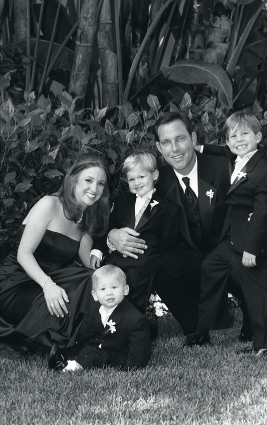 Black and white portrait of ring bearers and parents
