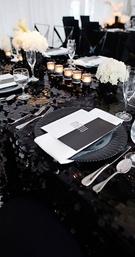 Black and white geometric wedding menu at table