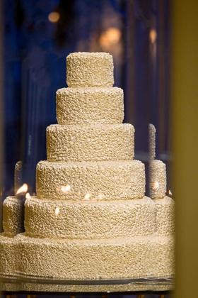 White ruffle wedding cake with round tiers