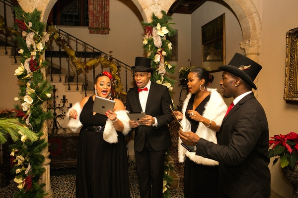 Holiday wedding with African-American carolers in tuxes, black dresses at Chateau Pleasantdale