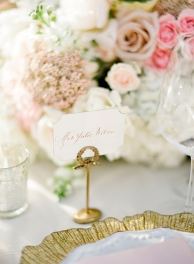 Wedding reception place card in a gold holder