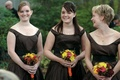 Three bridesmaids in brown dresses hold fall bouquets