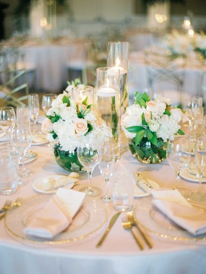 wedding reception centerpiece small round vases white hydrangea pink flower rose floating candles