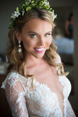close up bridal shot pink lipstick natural look makeup flower crown greenery dangle earrings