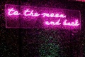 wedding reception hedge wall custom neon sign pink to the moon and back