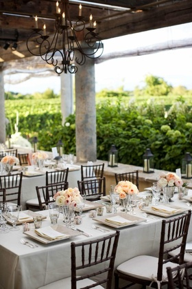 Wrought-iron chandelier and natural tablescape