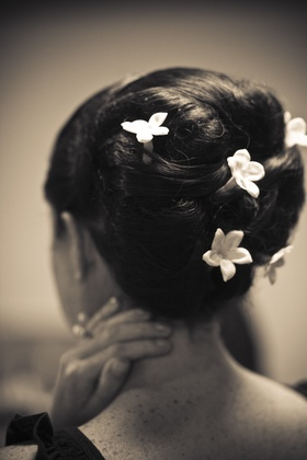Black and white photo of hairstyle with stephanotis