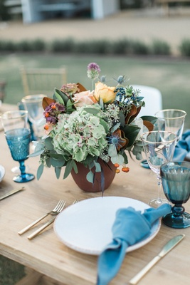 low vibrant rustic floral arrangement california winter wedding styled shoot boho outdoors wood
