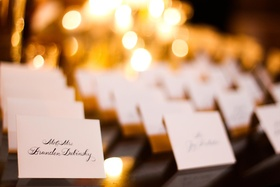 white place cards with black calligraphy