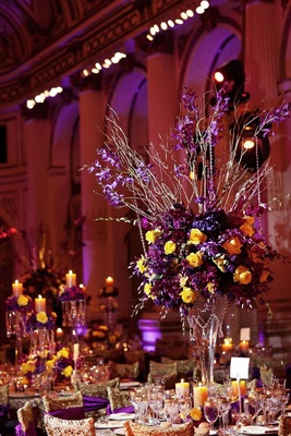 Purple and yellow rose centerpiece and gold chairs