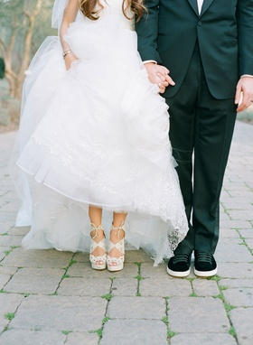 Bride with white pedicure, Belinda Charlotte Olympia shoes and Adam Ottavino in black sneakers