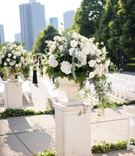 outdoor wedding ceremony white risers and urns field museum ceremony white greenery arrangements