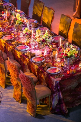 fire-inspired wedding styled shoot, glittery orange decorative chair covers, warm colors linen