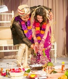 bride and groom wed in traditional Indian Hindu ceremony