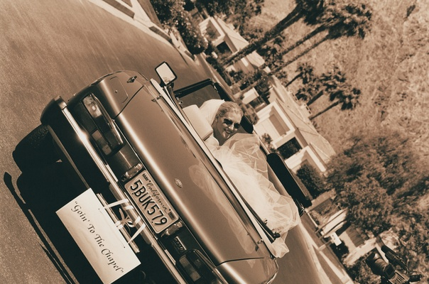 Sepia tone wedding getaway car in Palm Springs