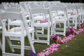 pink, lavender, magenta rose petals line aisle, parasols on chairs at wedding ceremony