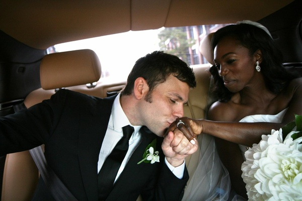 Joe Gasparik kisses Enuka Okuma's hand in limo