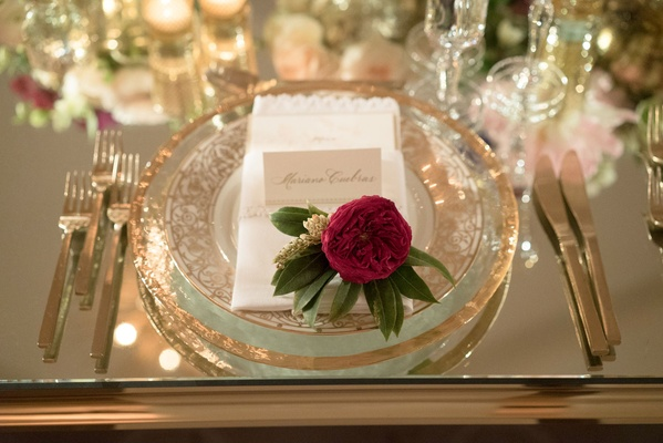 Single flower at place setting wedding guest reception seat gold charger plate gilt flatware mirror