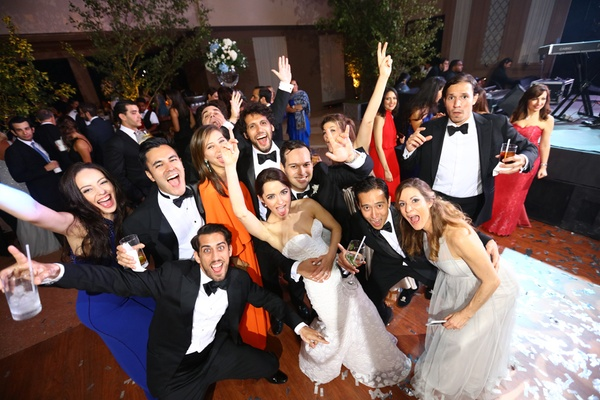 fun wedding party pose friends dominican republic wedding celebration lively