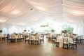tented reception with draped ceiling with open garden space