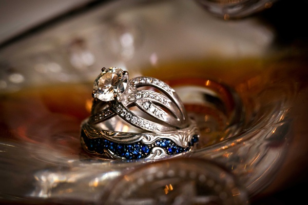 Groom's blue sapphire wedding band and bride's vintage inspired antique wedding engagement ring