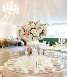 calamigos ranch tented wedding reception, clear chiavari chairs, blush and ivory centerpieces