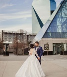 Wedding venue in Dallas Texas bride in low back long sleeve ball gown groom in navy tuxedo