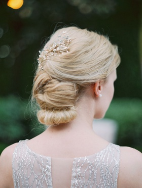 bride in lazaro silver sparkle wedding dress with low updo coiffure blonde hair pearl gold crystal