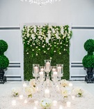 Wedding reception textured linen on round table flower arrangements candle votives hedge boxwoo