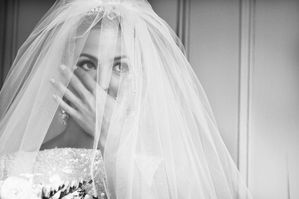 Black and white photo of Keri Lynn Pratt in veil