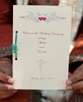 Ceremony booklet tied with blue glitter ribbon
