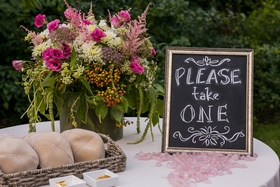 Tan yarmulkes on ceremony table with chalkboard frame