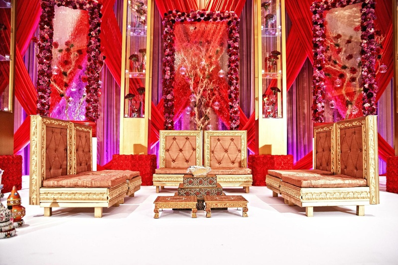 Indian wedding ceremony with golden seating at the altar