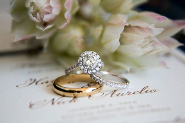 Round diamond engagement ring with halo pave band and pave diamond wedding ring men's gold band