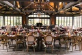 rustic old-europe themed reception hall with tall windows wooden beams and signs better together