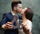 Cute bride and groom kissing portrait