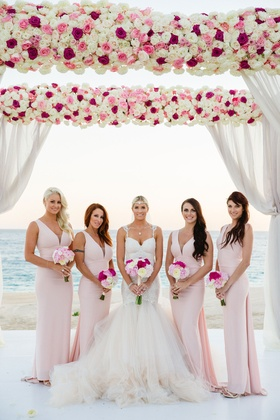 Bridesmaids at Barbie Blank's destination beach wedding pink dresses and flowers