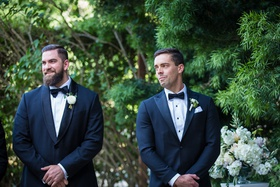 groom and best man tearing up as bride walks down the aisle, groom in navy suit