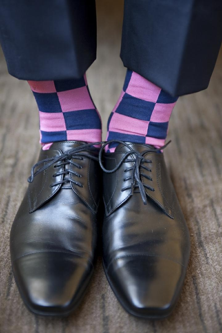 Groom wearing Oxford shoe with checkered socks
