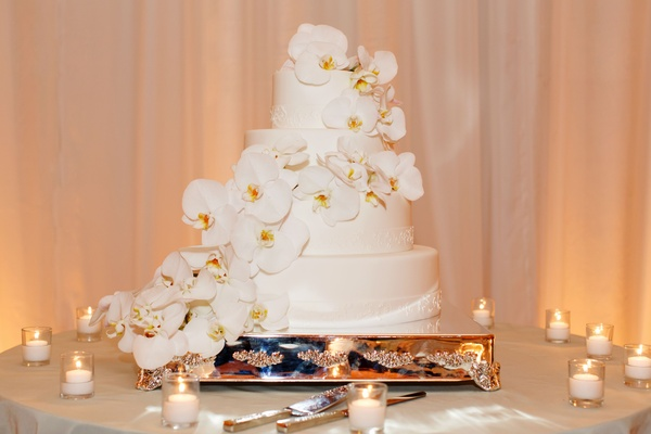 Four layer cake decorated with cascading orchids