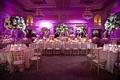 Purple ballroom wedding reception with classic decorations