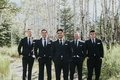 groom in Ermenegildo Zegna and groomsmen in black suits among birch trees in banff