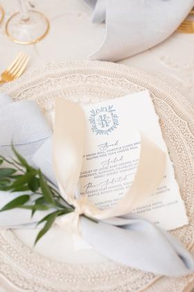wedding reception charger plate with white torn edge menu monogram blue grey script napkin ribbon