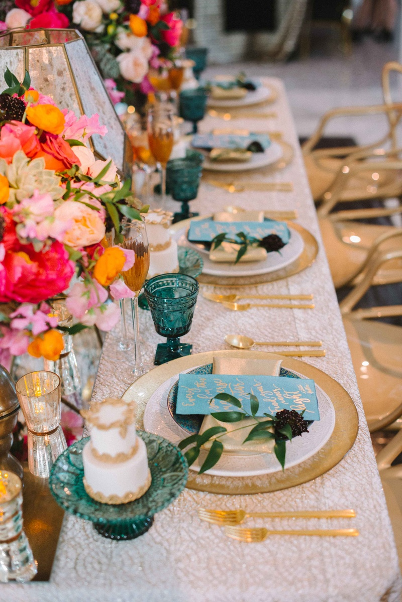 white linen gold blue plates wedding reception pink orange flowers blue goblets