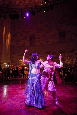 Actress Reshma Shetty in a navy and silver sari does Bollywood dance with groom