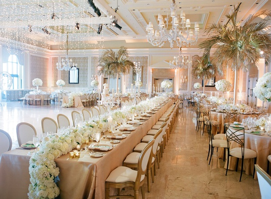Wedding reception the breakers chandeliers palm trees gold from tables long table flower runner